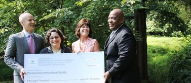 At a presentation are (from left) Drew Becher, Pennsylvania Horticultural Society; Julie Slavet, Tookany/Tacony-Frankford Watershed Partnership; Barbara McCabe, Philadelphia Parks &amp; Recreation; William C. Early, U.S. Environmental Protection Agency. (EPA photo)  <br />